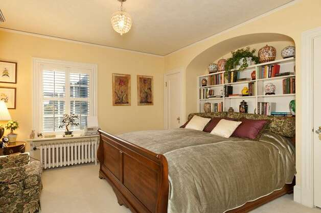 Bedroom suite of 1323 Willard Ave. W. The 5,290-square-foot brick colonial, built in 1928, has five bedrooms, 4.75 bathrooms, marble floors, radiators, a family room, a bar and expansive views on a terraced, 9,778-square-foot lot. It's listed for $2.598 million. Photo: Courtesy Carol Ard/Windermere Real Estate