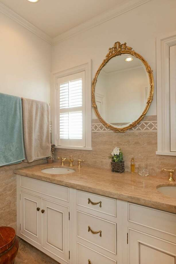 Master bathroom of 1323 Willard Ave. W. The 5,290-square-foot brick colonial, built in 1928, has five bedrooms, 4.75 bathrooms, marble floors, radiators, a family room, a bar and expansive views on a terraced, 9,778-square-foot lot. It's listed for $2.598 million. Photo: Courtesy Carol Ard/Windermere Real Estate