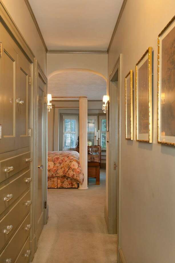 Master suite of 1323 Willard Ave. W. The 5,290-square-foot brick colonial, built in 1928, has five bedrooms, 4.75 bathrooms, marble floors, radiators, a family room, a bar and expansive views on a terraced, 9,778-square-foot lot. It's listed for $2.598 million. Photo: Courtesy Carol Ard/Windermere Real Estate