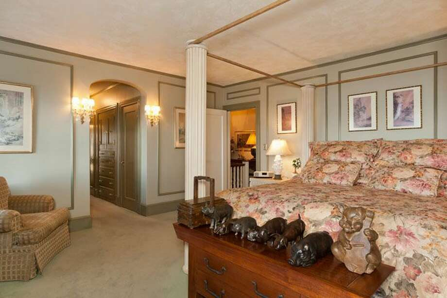 Master bedroom of 1323 Willard Ave. W. The 5,290-square-foot brick colonial, built in 1928, has five bedrooms, 4.75 bathrooms, marble floors, radiators, a family room, a bar and expansive views on a terraced, 9,778-square-foot lot. It's listed for $2.598 million. Photo: Courtesy Carol Ard/Windermere Real Estate