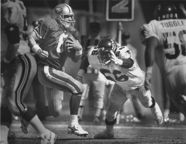 San Francisco 49ers quarterback Steve Young runs for a touchdown against Atlanta Falcons, on October 13, 1991. Photo: Scott Sommerdorf