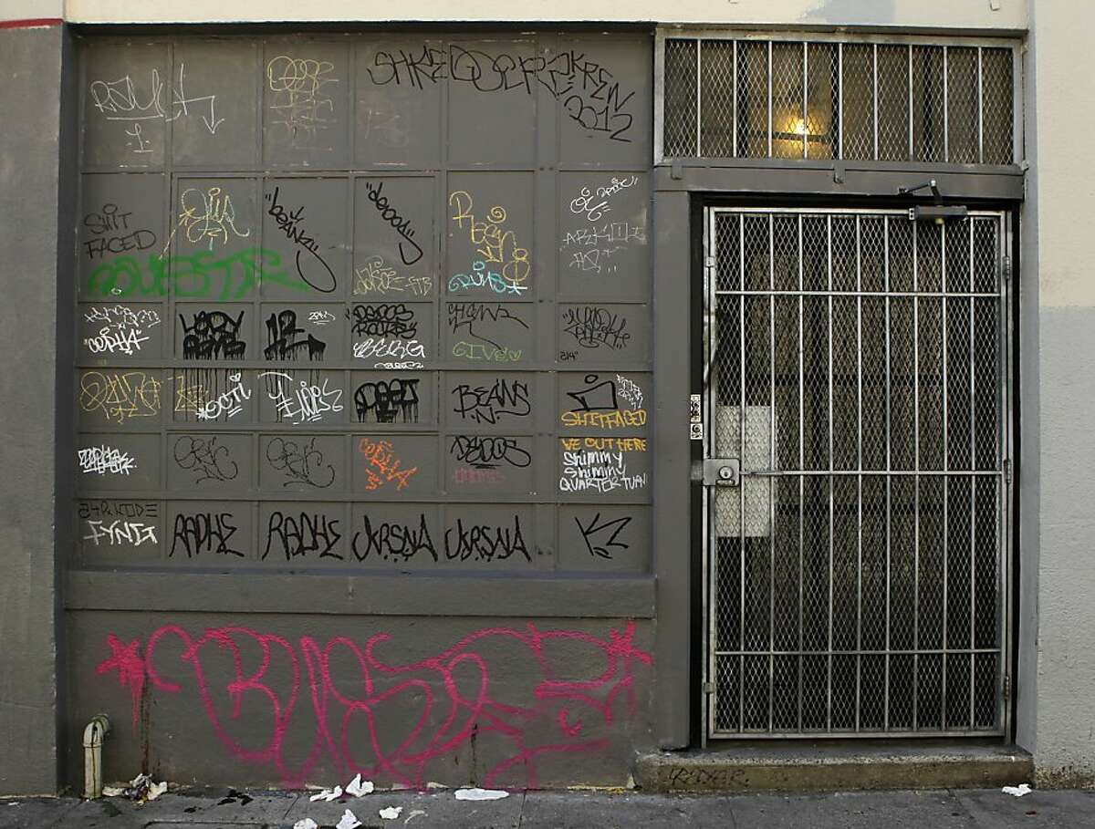 Graffiti covers a building on a South of Market alley in San Francisco, Calif. on Thursday, Jan. 17, 2013.