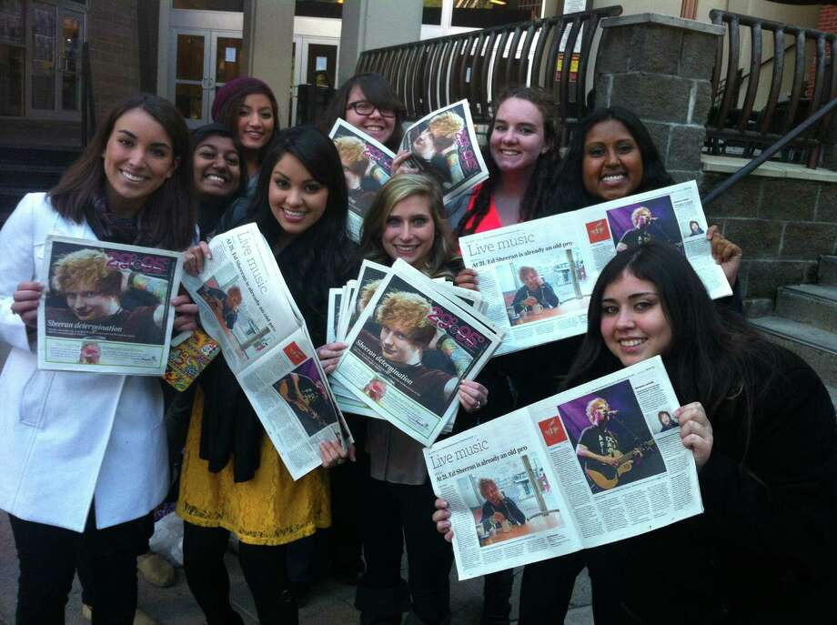 Fans holding up the 29-95 cover story on Ed Sheeran. Joey Guerra/Chronicle Photo: Joey Guerra/Chronicle, Joey Guerra