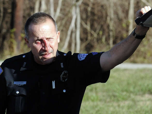 Two Beaumont officers were injured on  Thursday, January 17, 2013, while chasing a suspect on foot.  Officers stopped a car at the intersection of Martin Luther King Boulevard and Franklin Street when the passenger of the car fled the scene, the department reports. A brief foot chase followed before the man was arrested. Photo taken: Randy Edwards/The Enterprise
