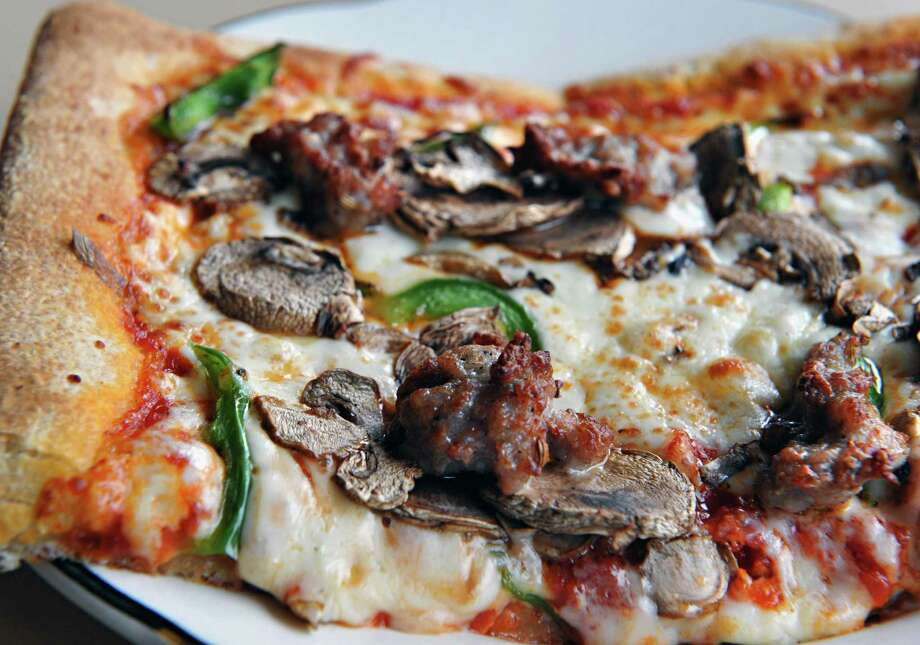 Sausage, mushroom and pepper pizza square at Sciortino's, formerly the Miss Albany Diner, on Broadway in Albany Saturday Jan 12, 2013.  (John Carl D'Annibale / Times Union) Photo: John Carl D'Annibale / 00020731A