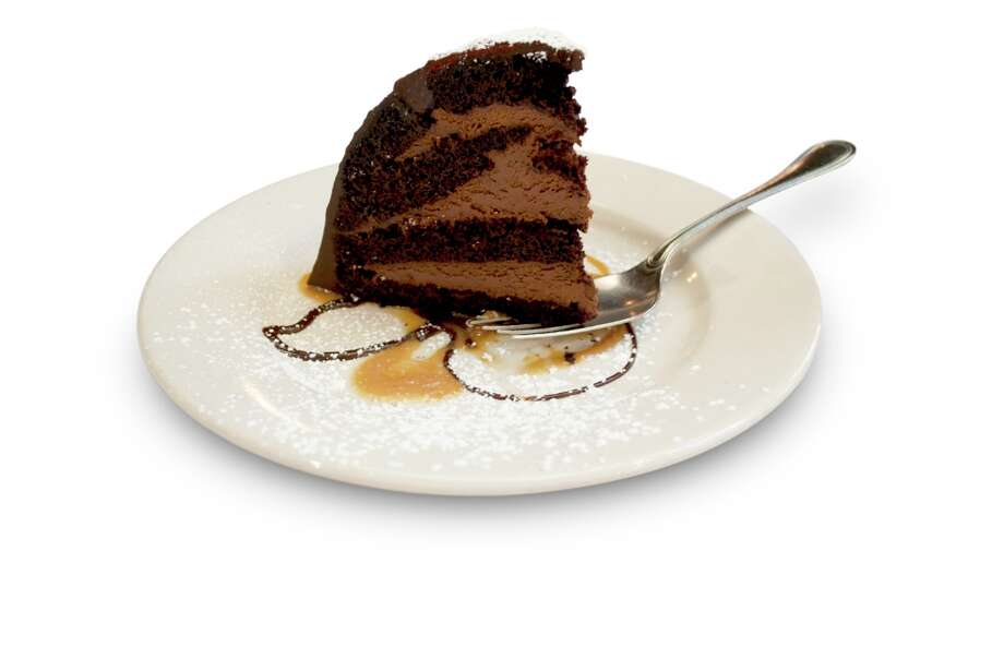 Chocolate Zuccotto Cake at Maggiano's Little Italy: 1,820 calories, 62 grams of saturated fat, 26 teaspoons of added sugar. A slice of this cake is five inches tall, four inches wide and weighs almost one pound.
