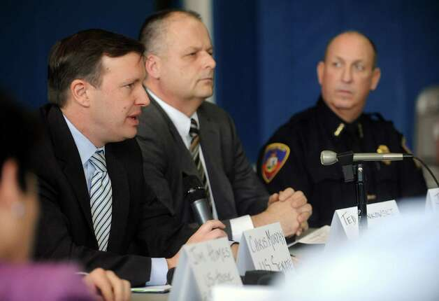 U.S. Senator Chris Murphy (D-Conn.), left, speaks during a roundtable discussion about curbing gun violence at the Yerwood Community Center in Stamford on Thursday, January 17, 2013. Photo: Lindsay Perry / Stamford Advocate