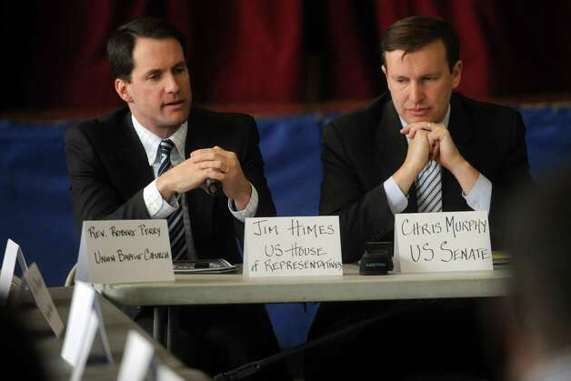 U.S. Rep. Jim Himes (D-Conn.), left, and U.S. Sen. Chris Murphy (D-Conn.), right, speak during a roundtable discussion about curbing gun violence at the Yerwood Community Center in Stamford on Thursday, January 17, 2013. Photo: Lindsay Perry / Stamford Advocate