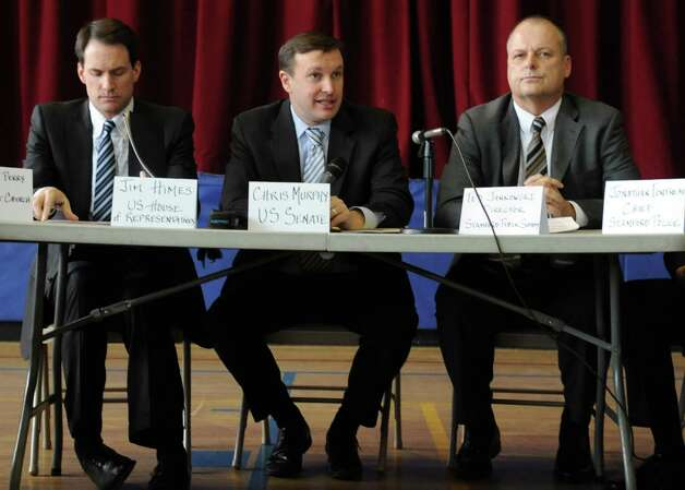 U.S. Sen. Chris Murphy (D-Conn.), center, is flanked by U.S. Rep. Jim Himes (D-Conn.), left, and Stamford Director of Public Safety Ted Jankowski, right, as he speaks during a roundtable discussion about curbing gun violence at the Yerwood Community Center in Stamford on Thursday, January 17, 2013. Photo: Lindsay Perry / Stamford Advocate