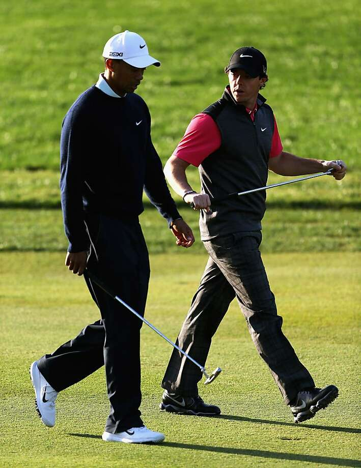 Tiger Woods (left) and Rory McIlroy played together, and not particularly well, though Woods finished at even par. Photo: Matthew Lewis, Getty Images