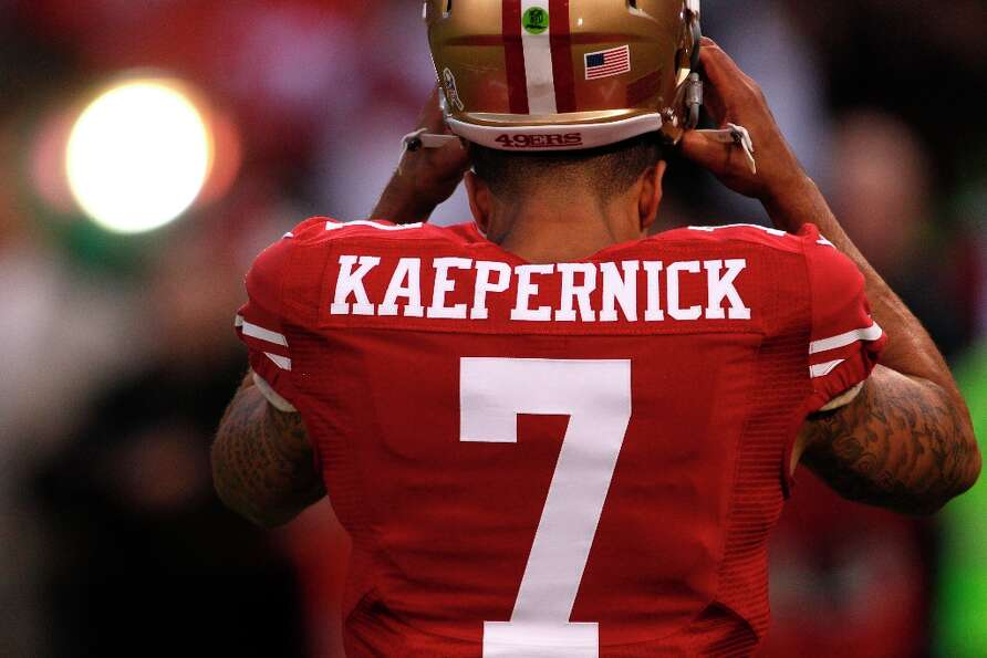 Quarterback Colin Kaepernick puts on his helmet on Nov. 19, 2012, the day of his first NFL start.
