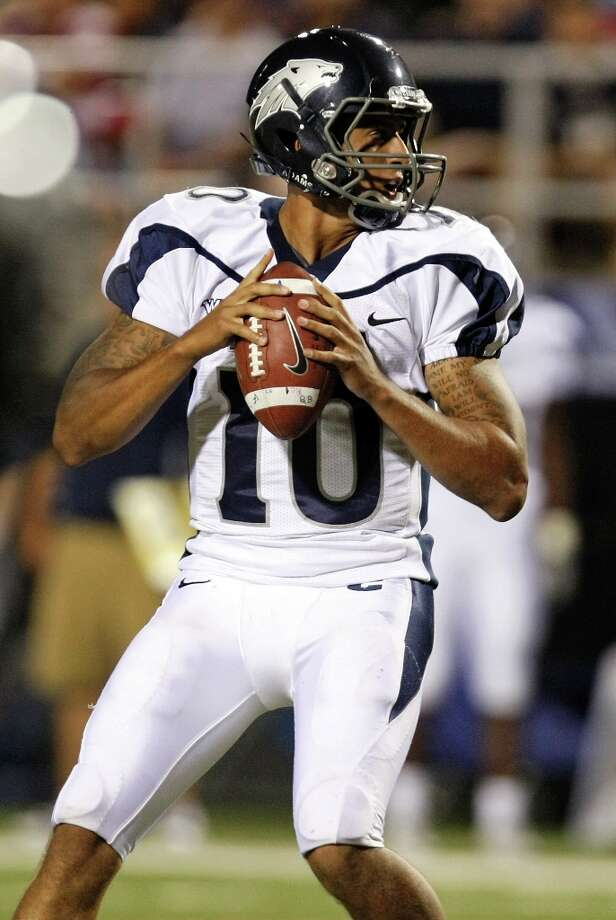 From his college days: Kaepernick of the Nevada Wolf Pack looks to pass against the UNLV Rebels in the third quarter of their game at Sam Boyd Stadium October 2, 2010 in Las Vegas, Nevada. Photo: Ethan Miller, Getty Images / ONLINE_YES