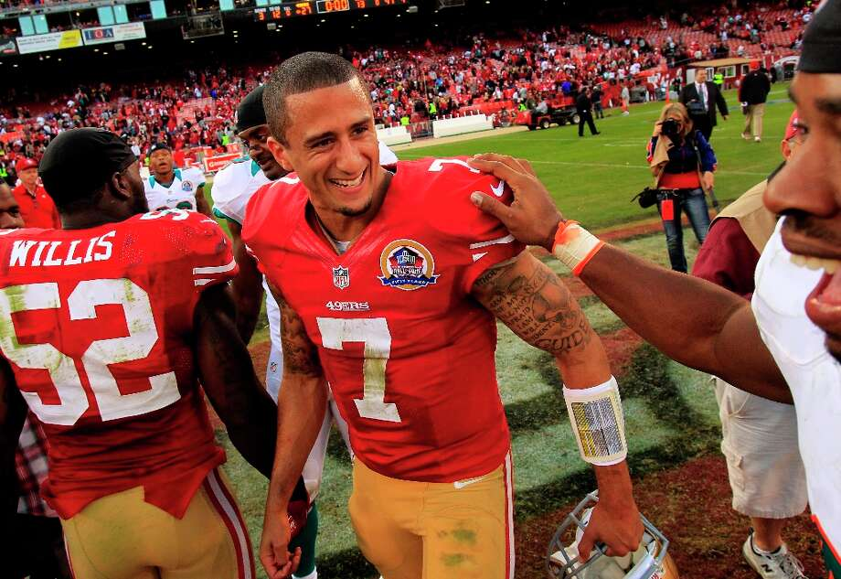 Colin Kaepernick was congratulated by the Dolphins Cameron Wake at the end of the game. The San Francisco 49ers defeated the Miami Dolphins 27-13 at Candlestick Park in San Francisco, Calif. Sunday December 9, 2012. Photo: Brant Ward, The Chronicle / ONLINE_YES