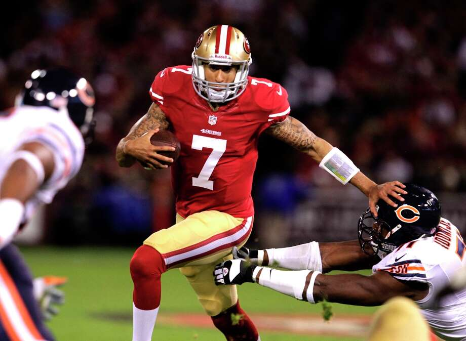 Quarterback Colin Kaepernick for a gain in the second quarter of the San Francisco 49ers game against the Chicago Bears at Candlestick Park in San Francisco, Calif., on Sunday November 19, 2012. Photo: Brant Ward, The Chronicle / ONLINE_YES
