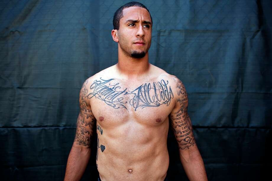 Colin Kaepernick shows off his many tattoos at the 49ers practice facility. Photo: Michael Short, Special To The Chronicle / ONLINE_YES