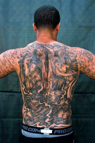 Kap's enormous back art. Photo: Michael Short, Special To The Chronicle / ONLINE_YES