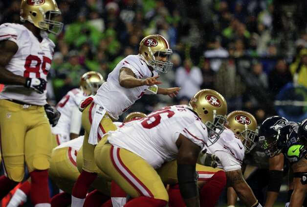 Colin Kaepernick calls out to his teammates at the line of scrimmage during the first half of the Seahawks and 49ers game Sunday, Dec. 23, 2012, at CenturyLink Field in Seattle, WA. Photo: JORDAN STEAD, SFC / ONLINE_YES