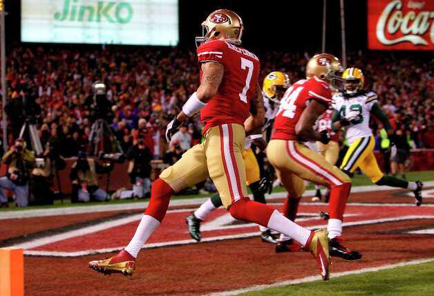 Quarterback Colin Kaepernick runs in a touchdown in the first quarter of the San Francisco 49ers game against the Green Bay Packers in the NFC Divisional Playoffs at Candlestick Park in San Francisco, Calif., on Saturday January 12, 2013. Photo: Michael Macor, The Chronicle / ONLINE_YES