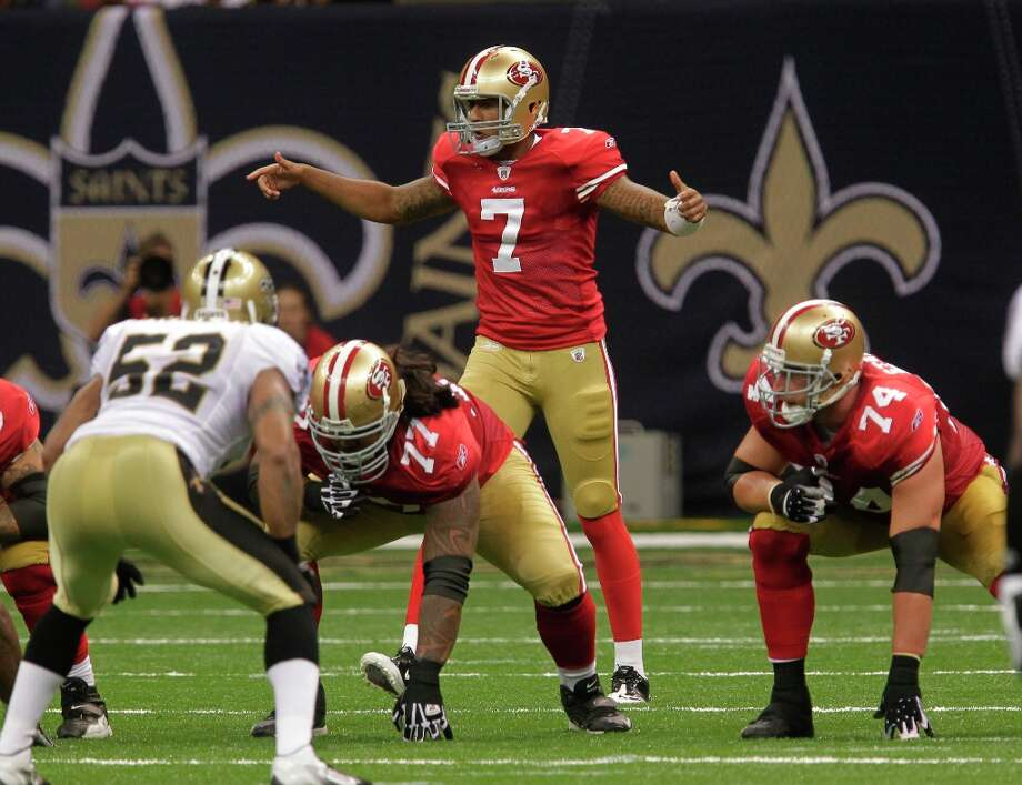 Kaepernick calls the play against the New Orleans Saints at the Louisiana Superdome in New Orleans, Friday, Aug. 12, 2011. Photo: Bill Haber, AP / FR170136 AP