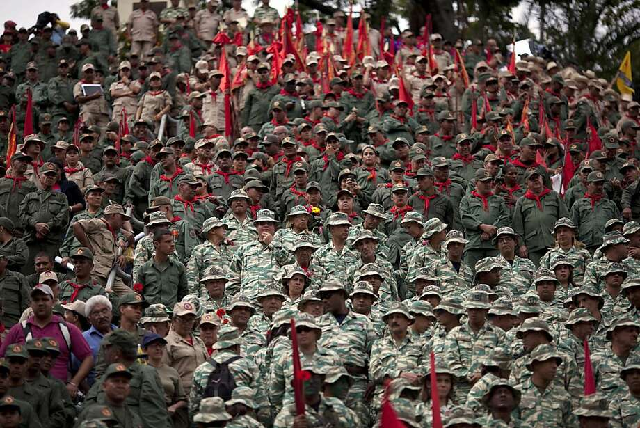 Members of Venezuela's Bolivarian militia attend the symbolic inauguration for President Hugo Chavez in Caracas, Venezuela, on Jan. 10. Photo: Ariana Cubillos, Associated Press