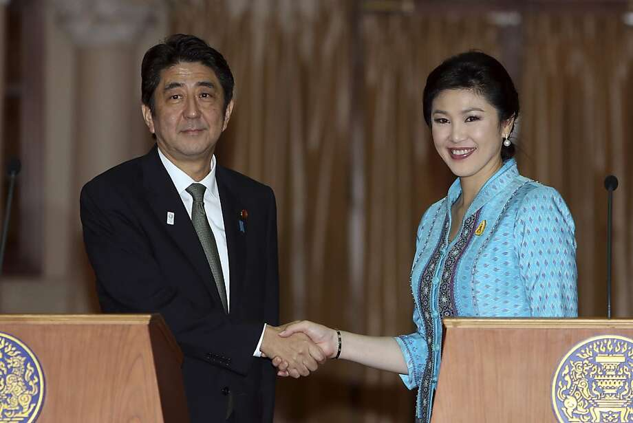 Shinzo Abe, Japan's prime minister, left, shakes hands with Yingluck Shinawatra, Thailand's prime minister, following a news conference in Bangkok, Thailand, on Thursday, Jan. 17, 2013. Abe is visiting Vietnam, Thailand and Indonesia this week to strengthen bonds with Southeast Asian nations. Photographer: Dario Pignatelli/Bloomberg *** Local Caption *** Shinzo Abe; Yingluck Shinawatra Photo: Dario Pignatelli, Bloomberg