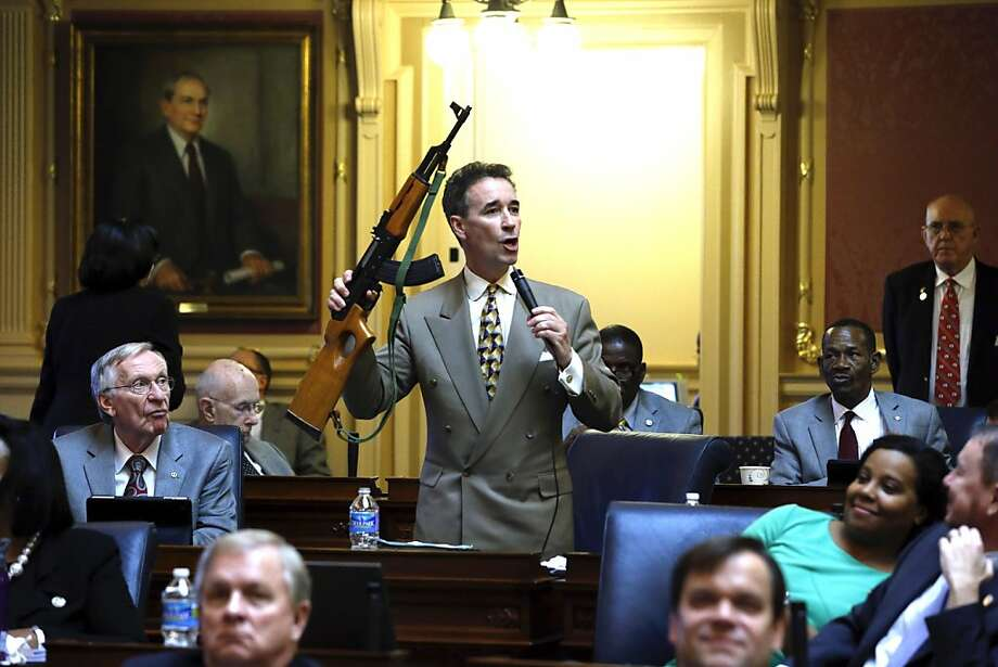 Joe Morrissey, a Democrat in the Virginia House of Delegates, holds an assault rifle during a speech at the State Capitol in Richmond as he urges stricter controls on such weapons. Photo: Bob Brown, Associated Press