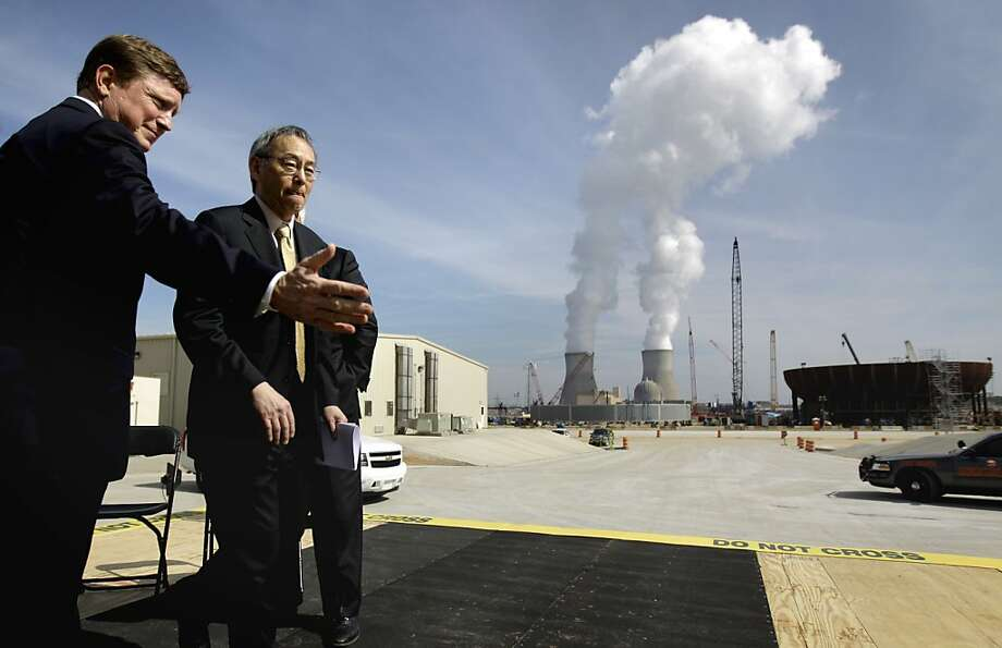Energy Secretary Steven Chu (right), seen during a visit to a nuclear plant in Georgia with Southern Co. CEO Thomas Fanning last year, will step down. Photo: David Goldman, Associated Press