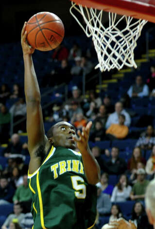 Trinity Catholic's Brandon Wheeler coverts a layup during the Northeast Christmas Classic against LaSalle Academy at the Webster Bank Arena in Bridgeport on Thursday, December 27, 2012. Photo: Christian Abraham