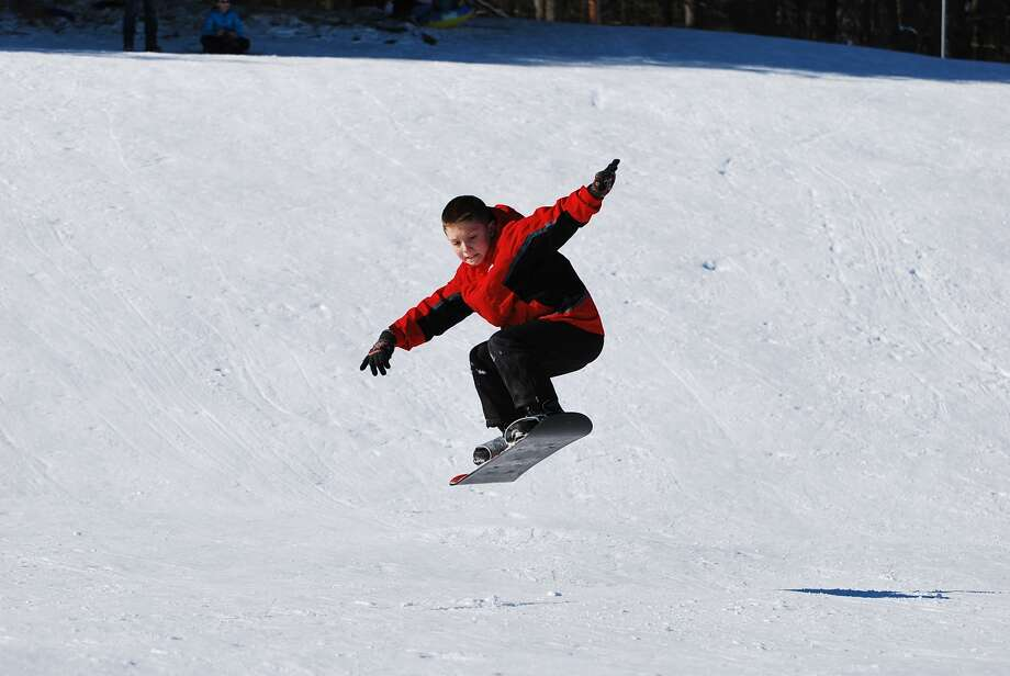 Ryan Dollar, 10, of Ballston Lake catches some air while snowboarding at Longkill Park. (Jeanne Dollar)