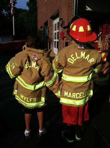 Myles and Marcelle McAdoo were declared honorary Delmar firefighters. Myles McAdoo died Tuesday, July 24, 2012 after a recurrence of brain cancer, six months after the diagnosis. In that time in between he lived a full life. (Laurel McAdoo)