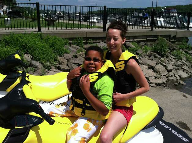 Myles McAdoo Jet Skiing in Coeymans. Myles McAdoo died Tuesday, July 24, 2012 after a recurrence of brain cancer, six months after the diagnosis. In that time in between he lived a full life. (Laurel McAdoo)