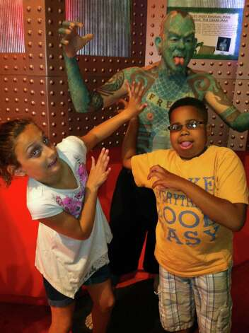 With a friend at Ripley's Museum in New York City. Myles McAdoo died Tuesday, July 24, 2012 after a recurrence of brain cancer, six months after the diagnosis. In that time in between he lived a full life. (Laurel McAdoo)