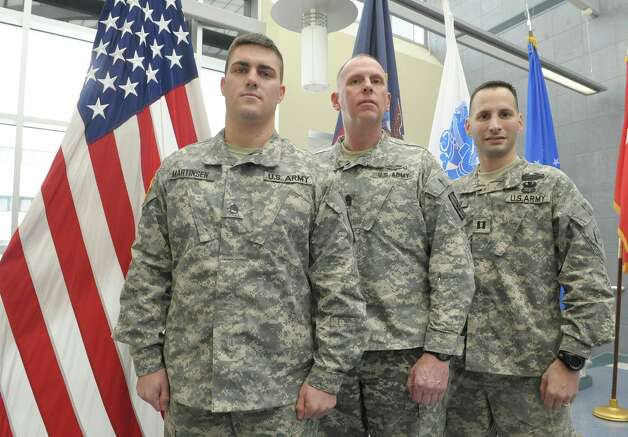 Members of the New York Army National Guard, from left to right, Staff Sgt. David Martinsen, of Troy, New York State Command Sgt. Major Frank Wicks, of West Sand Lake and Captain Shawn Tabankin, of Rexford, pose for a photograph at the New York Army National Guard headquarters on Thursday, Jan. 17, 2013 in Latham, NY.  The three men will be attending with a guest the Commander-in-Chief's Inaugural Ball on Monday, January 21st in Washington.  All three service members are veterans of the wars in Iraq and Afghanistan.  Tabankin has been awarded the Purple Heart and Martinsen was the New York Army National Guard full-time Non-Commissioned Officer of the Year for 2012. (Paul Buckowski / Times Union) Photo: Paul Buckowski  / 00020817A