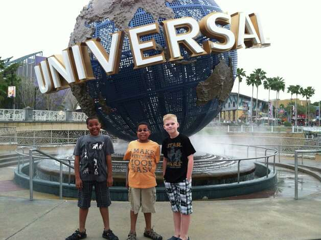 Marcelle and Myles McAdoo with friend Hayden Fisher (l. to. r) at Universal in Orlando, Fla. Myles McAdoo died Tuesday,  July 24, 2012 after a recurrence of brain cancer, six months after the diagnosis. In that time in between he lived a full life. (Laurel McAdoo)
