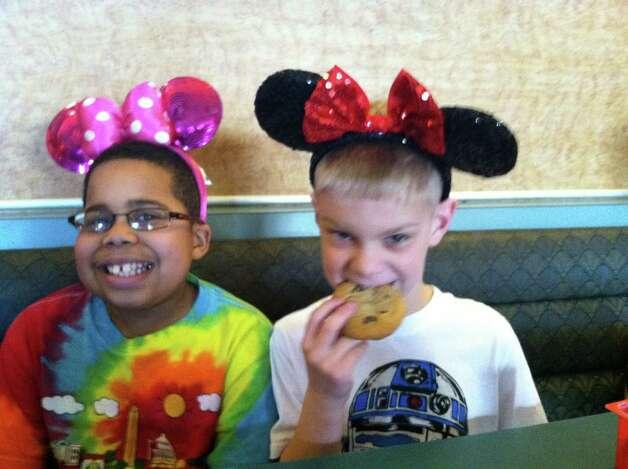 Myles McAdoo with friend Quinn Fisher in Orlando. Myles McAdoo died Tuesday, July 24, 2012 after a recurrence of brain cancer, six months after the diagnosis. In that time in between he lived a full life. (Laurel McAdoo)