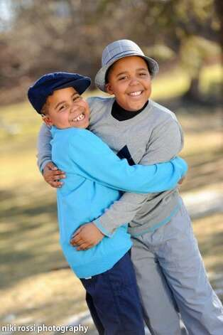 Myles and Marcelle McAdoo. Myles McAdoo died Tuesday, July 24, 2012 after a recurrence of brain cancer, six months after the diagnosis. In that time in between he lived a full life. (Nikki Rossi Photography) Photo: Kristen Hines