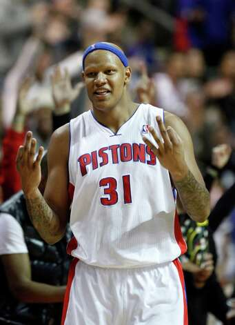 Detroit Pistons forward Charlie Villanueva (31) reacts after sinking another three point basket against the Miami Heat in the second half of an NBA basketball game Friday, Dec. 28, 2012, in Auburn Hills, Mich. (AP Photo/Duane Burleson) Photo: Duane Burleson, Associated Press / FR38952 AP
