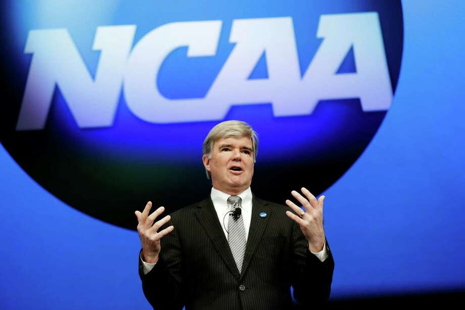 NCAA President Mark Emmert speaks at the organization's annual convention, Thursday, Jan. 17, 2013, in Grapevine, Texas. Emmert delivered his state of the association address on the second day of the group's convention, where several reform measures are on the agenda in the wake of high-profile scandals. The board could make sweeping changes this week, including rules about communicating recruits. (AP Photo/LM Otero) Photo: LM Otero, Associated Press / AP