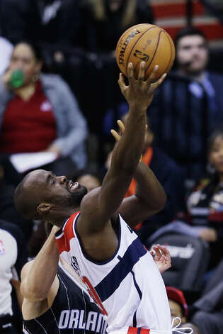 WASHINGTON, DC - JANUARY 14: Emeka Okafor #50 of the Washington Wizards puts up a shot in front of Nikola Vucevic #9 of the Orlando Magic during the first half at Verizon Center on January 14, 2013 in Washington, DC. NOTE TO USER: User expressly acknowledges and agrees that, by downloading and or using this photograph, User is consenting to the terms and conditions of the Getty Images License Agreement.  (Photo by Rob Carr/Getty Images) Photo: Rob Carr, Getty Images / 2013 Getty Images