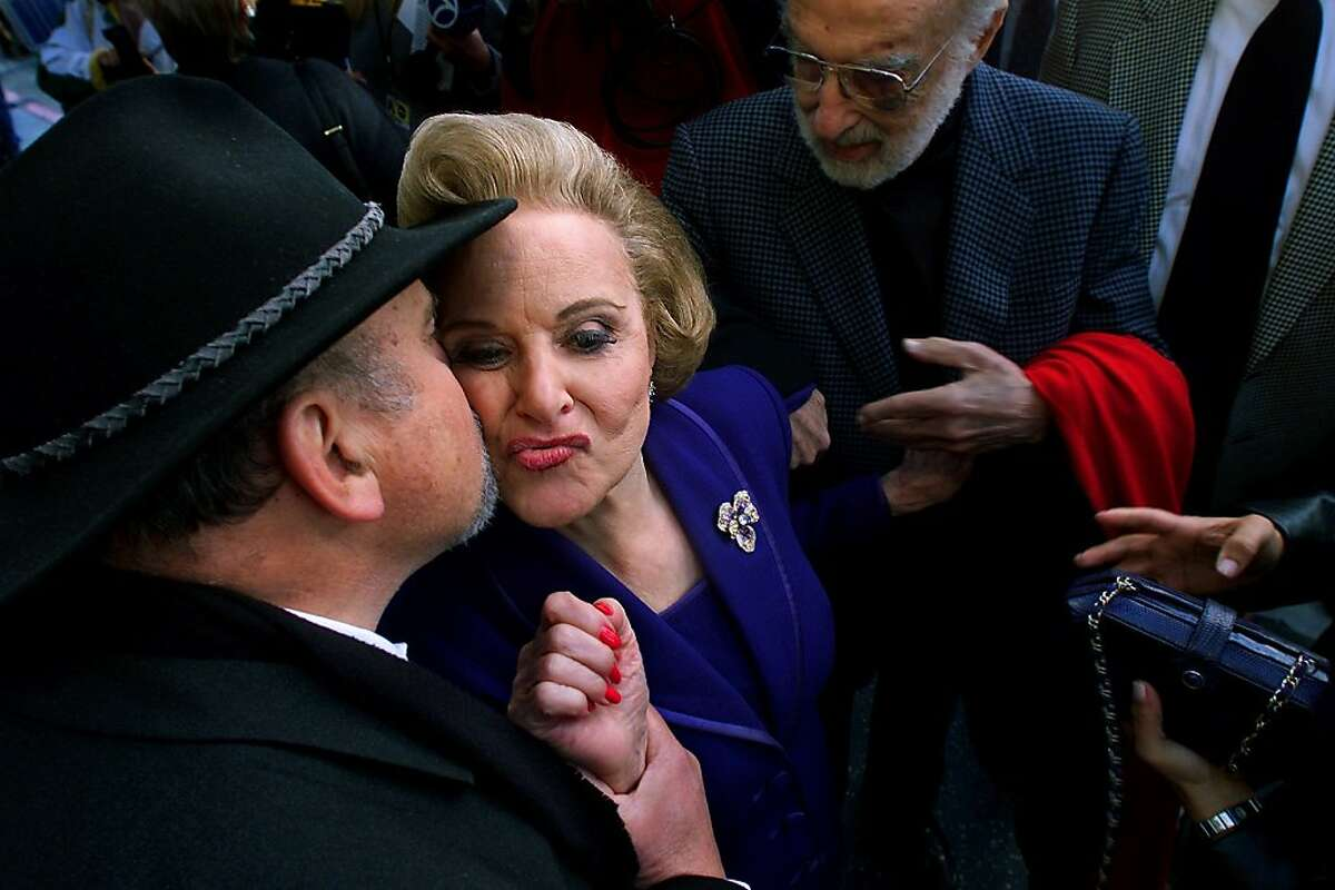 """Dear Abby, aka Pauline Phillips, gets a kiss from Dick Guttman after receiving her star on the Hollywood Walk of Fame in front of the Hollywood Roosevelt Hotel, February 14, 2001. Pauline Friedman Phillips, who as Abigail Van Buren - """"Dear Abby"""" - for more than 40 years dispensed advice to newspaper readers worldwide on everything from snoring spouses to living wills, died Wednesday. She was 94. (Carolyn Cole/Los Angeles Times/MCT)"""