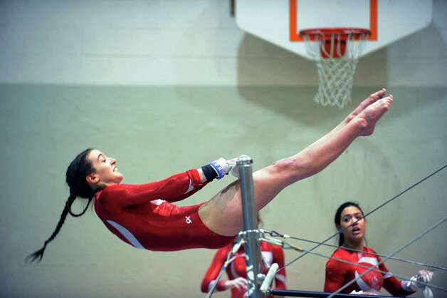 Tori Mann of Greenwich on the uneven bars during the girls gymnastics meet between Staples High School and Greenwich High School at the YWCA in Greenwich, Thursday afternoon, Jan. 17, 2013. Photo: Bob Luckey / Greenwich Time