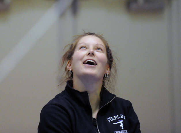 Staples gymnastics coach Kelsey Martin smiles during the girls gymnastics meet between Staples High School and Greenwich High School at the YWCA in Greenwich, Thursday afternoon, Jan. 17, 2013. Photo: Bob Luckey / Greenwich Time