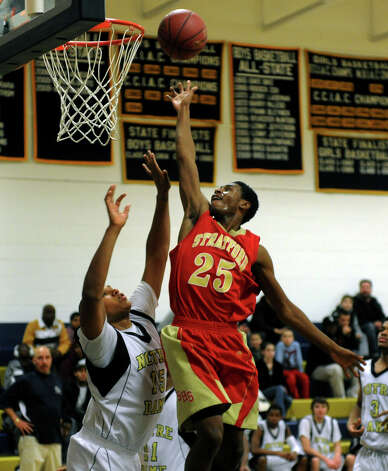 Stratford's #25 Bernard Brantley lays up the ball over Notre Dame of Fairfield's #15 Arkel Miles, during boys basketball action in Fairfield, Conn. on Friday January 20, 2012. Photo: Christian Abraham / Connecticut Post