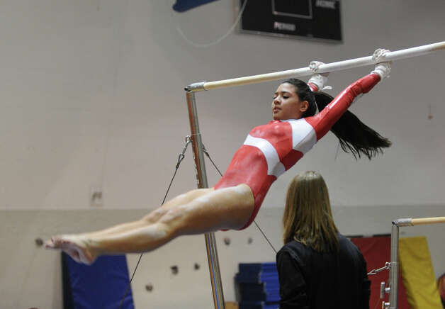 Kat McCaffrey of Greenwich on the uneven bars during the girls gymnastics meet between Staples High School and Greenwich High School at the YWCA in Greenwich, Thursday afternoon, Jan. 17, 2013. Photo: Bob Luckey / Greenwich Time