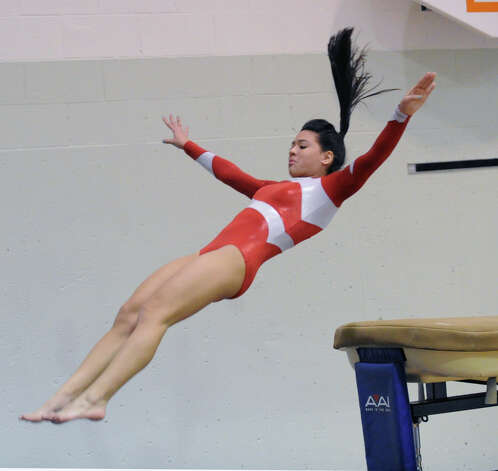 Kat McCaffrey of Greenwich vaults during the girls gymnastics meet between Staples High School and Greenwich High School at the YWCA in Greenwich, Thursday afternoon, Jan. 17, 2013. Photo: Bob Luckey / Greenwich Time