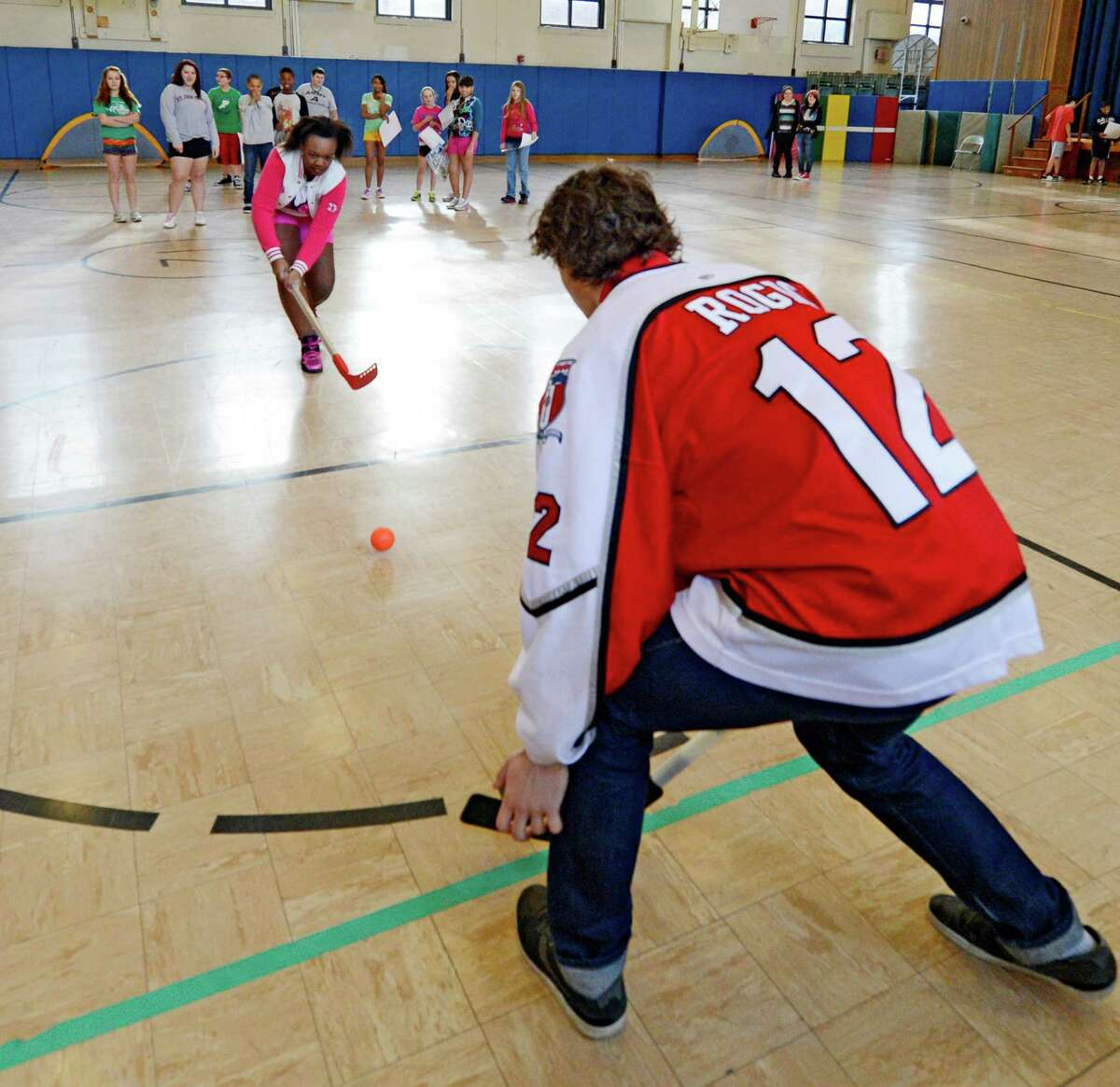 Johnny Rogic of the RPI mens? hockey team shows students how to block shots at the goal during a demonstration Thursday afternoon, Jan. 17, 2013, at Doyle Middle School (Troy School 12) in Troy, N.Y. (Skip Dickstein/Times Union)