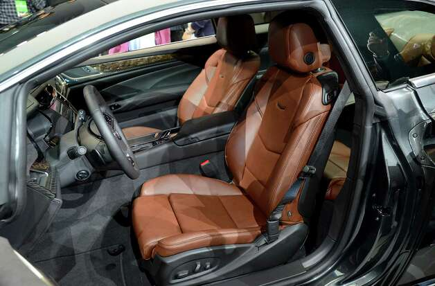 The interior of the General Motors Co. (GM) Cadillac ELR coupe vehicle is seen after the unveiling at the 2013 North American International Auto Show (NAIAS) in Detroit, Michigan, U.S., on Tuesday, Jan. 15, 2013. The Detroit auto show runs through Jan. 27 and will display over 500 vehicles, representing the most innovative designs in the world. Photographer: David Paul Morris/Bloomberg Photo: David Paul Morris, Bloomberg / © 2013 Bloomberg Finance LP