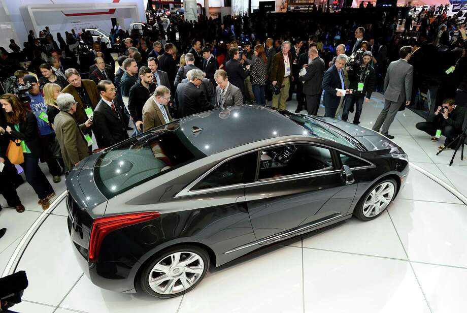 Members of the media view the General Motors Co. (GM) Cadillac ELR coupe vehicle after the unveiling at the 2013 North American International Auto Show (NAIAS) in Detroit, Michigan, U.S., on Tuesday, Jan. 15, 2013. The Detroit auto show runs through Jan. 27 and will display over 500 vehicles, representing the most innovative designs in the world. Photographer: David Paul Morris/Bloomberg Photo: David Paul Morris, Bloomberg / © 2013 Bloomberg Finance LP