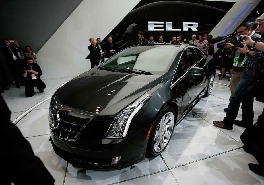 The 2014 Cadillac ELR is introduced at the 2013 North American International Auto Show in Detroit, Michigan, on January 15, 2013.    AFP PHOTO/Geoff RobinsGEOFF ROBINS/AFP/Getty Images Photo: GEOFF ROBINS, AFP/Getty Images / AFP