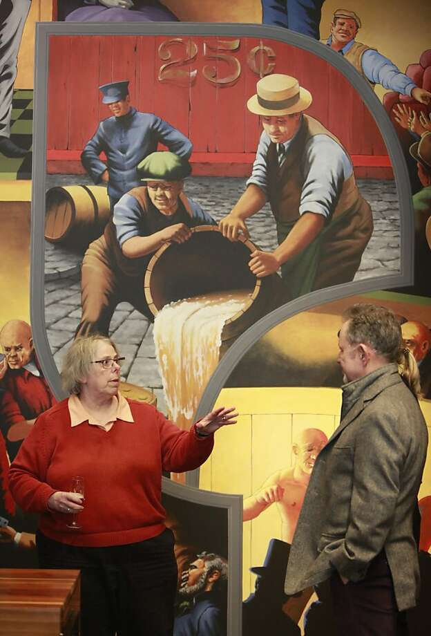 Paula Lichtenberg (left), law offices librarian, with Mark Evans, Brown's partner who is writing a book about the mural. Photo: Lea Suzuki, The Chronicle